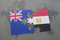 Puzzle with the national flag of new zealand and egypt on a world map background. Royalty Free Stock Photos