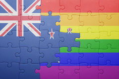 Puzzle with the national flag of new zealand and gay flag. Concept Stock Photos