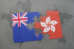 Puzzle with the national flag of new zealand and hong kong on a world map background. 3D illustration. Puzzle with the national flag of new zealand and hong kong Stock Photos