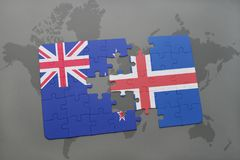 Puzzle with the national flag of new zealand and iceland on a world map background Royalty Free Stock Image