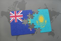 Puzzle with the national flag of new zealand and kazakhstan on a world map background Royalty Free Stock Images