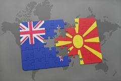 Puzzle with the national flag of new zealand and macedonia on a world map background Royalty Free Stock Photos
