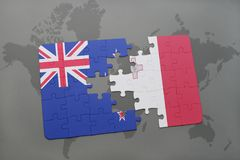 Puzzle with the national flag of new zealand and malta on a world map background Royalty Free Stock Photography