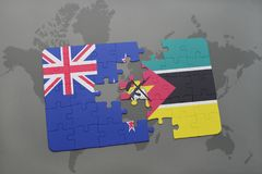 Puzzle with the national flag of new zealand and mozambique on a world map background. 3D illustration Stock Photo