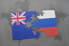 Puzzle with the national flag of new zealand and russia on a world map background Royalty Free Stock Image