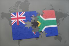 Puzzle with the national flag of new zealand and south africa on a world map background. Royalty Free Stock Images
