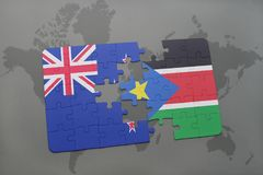 Puzzle with the national flag of new zealand and south sudan on a world map background. Royalty Free Stock Images