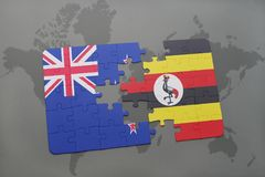 Puzzle with the national flag of new zealand and uganda on a world map background. Royalty Free Stock Photo