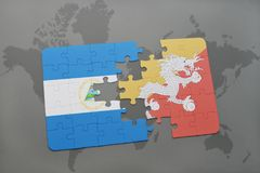 puzzle with the national flag of nicaragua and bhutan on a world map Stock Photography