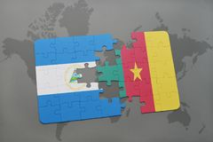 puzzle with the national flag of nicaragua and cameroon on a world map Royalty Free Stock Photos