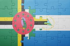 Puzzle with the national flag of nicaragua and dominica. Concept stock photo