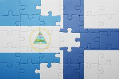 Puzzle with the national flag of nicaragua and finland Stock Photography