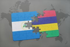 Puzzle with the national flag of nicaragua and mauritius on a world map. Background. 3D illustration Royalty Free Stock Photo