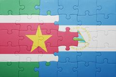 Puzzle with the national flag of nicaragua and suriname. Concept Stock Photo
