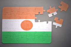 Puzzle with the national flag of niger Royalty Free Stock Photography