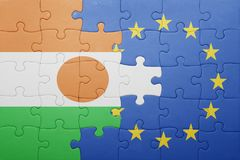 Puzzle with the national flag of niger and european union Stock Photo