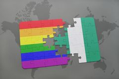 Puzzle with the national flag of nigeria and gay rainbow flag on a world map background. 3D illustration Stock Photos