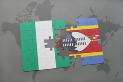 Puzzle with the national flag of nigeria and swaziland on a world map Stock Photography