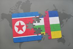puzzle with the national flag of north korea and central african republic on a world map Stock Images