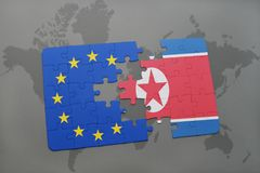 Puzzle with the national flag of north korea and european union on a world map. Background stock image