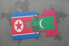 Puzzle with the national flag of north korea and maldives on a world map background. 3D illustration Royalty Free Stock Photos