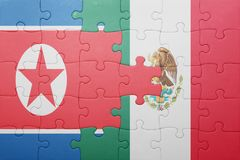 Puzzle with the national flag of north korea and mexico. Concept royalty free stock photo