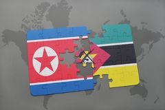 Puzzle with the national flag of north korea and mozambique on a world map. Background. 3D illustration Royalty Free Stock Photos