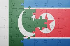 Puzzle with the national flag of north korea and pakistan Royalty Free Stock Photography