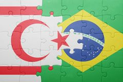 Puzzle with the national flag of northern cyprus and brazil Stock Photo