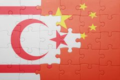 Puzzle with the national flag of northern cyprus and china Stock Image