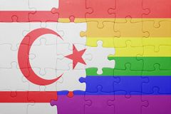Puzzle with the national flag of northern cyprus and gay flag Stock Photos
