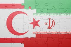 Puzzle with the national flag of northern cyprus and iran Stock Photos