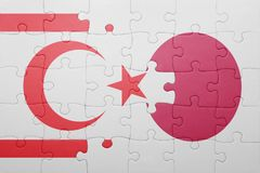 Puzzle with the national flag of northern cyprus and japan Royalty Free Stock Image