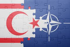Puzzle with the national flag of northern cyprus and nato Stock Images