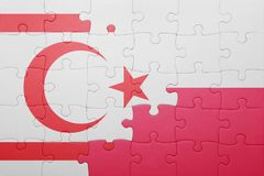 Puzzle with the national flag of northern cyprus and poland Royalty Free Stock Photography