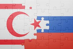 Puzzle with the national flag of northern cyprus and russia Stock Images