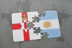 Puzzle with the national flag of northern ireland and argentina on a world map Royalty Free Stock Photography