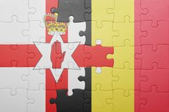 Puzzle with the national flag of northern ireland and belgium Stock Images