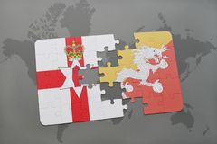 Puzzle with the national flag of northern ireland and bhutan on a world map. Background. 3D illustration Stock Photography