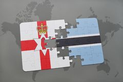Puzzle with the national flag of northern ireland and botswana on a world map Stock Photography