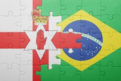 Puzzle with the national flag of northern ireland and brazil Stock Image