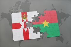 Puzzle with the national flag of northern ireland and burkina faso on a world map. Background. 3D illustration Stock Image