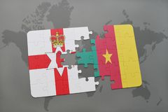 Puzzle with the national flag of northern ireland and cameroon on a world map Stock Image