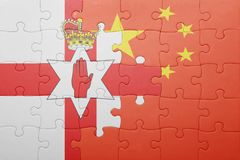 Puzzle with the national flag of northern ireland and china Royalty Free Stock Image