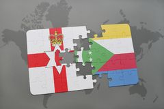 Puzzle with the national flag of northern ireland and comoros on a world map Stock Photo
