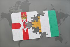 Puzzle with the national flag of northern ireland and cote divoire on a world map Stock Photography