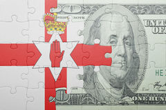Puzzle with the national flag of northern ireland and dollar banknote. Concept Stock Photo