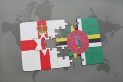 Puzzle with the national flag of northern ireland and dominica on a world map. Background. 3D illustration stock photo