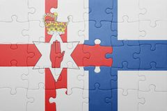 Puzzle with the national flag of northern ireland and finland Royalty Free Stock Photo