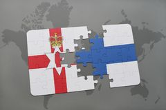 Puzzle with the national flag of northern ireland and finland on a world map background. Royalty Free Stock Photography